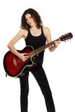 Curly brunette with guitar Royalty Free Stock Photos