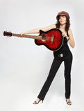 Curly brunette with guitar Royalty Free Stock Photography