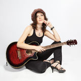Curly brunette with guitar Stock Images