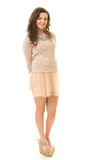 Curly Brunette In Pink Mini Skirt Stock Photography