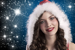 Curly brunette with santa hood Stock Image