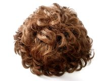 Curly brunette wig Royalty Free Stock Images
