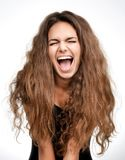 Curly brunette woman happy laughing excited looking up with closed eyes Stock Photography