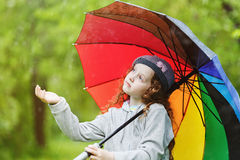 Curly child enjoy to spring rain outdoors. stock images