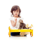 Curly child girl playing with kitten Stock Photo