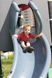 Curly child on slide Stock Image