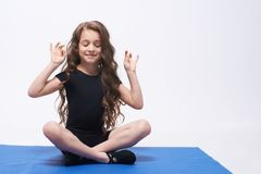 Yoga. Relax. Equilibrium. Lotus position. Curly girl. Brunette. Curly cute Brunette girl doing Yoga and Relax. Equilibrium. Lotus position Stock Photos