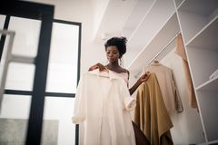 Free Curly Fashionable Woman Choosing Outfit For Day Royalty Free Stock Image - 161422966