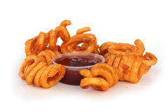 Curly Fries. Fried Curly Fries with Sauce Royalty Free Stock Photos