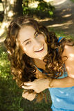 Curly girl. Is laughing outdoor Royalty Free Stock Image