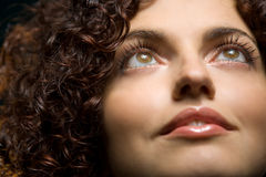 Curly girl. Nice curly girl is lookig up with smile Stock Photography