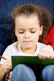 Curly girl with book and pencil Stock Image