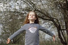 Curly girl breathing with fresh blowing air. Royalty Free Stock Photo