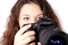 Curly girl with camera  Royalty Free Stock Photos