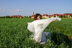 Curly girl dancing on nature Stock Images