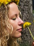 Curly girl and dandelion Royalty Free Stock Photo