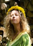 Curly girl with dandelion chain Royalty Free Stock Photography