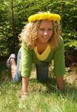 Curly girl with dandelion chain Stock Images