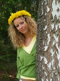 Curly girl with dandelion chain on head Stock Photos