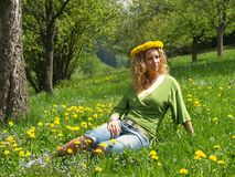 Curly girl with dandelion chain on head Stock Photo