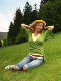 Curly girl with dandelion chain on head Stock Images