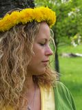 Curly girl with dandelion chain on head Stock Photography