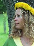 Curly girl with dandelion chain on head Royalty Free Stock Photos