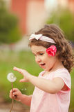 Curly girl with dandelion Stock Images