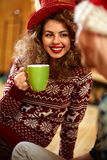 Curly girl drinking tea Royalty Free Stock Image