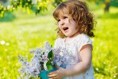 Curly girl in garden stock photos