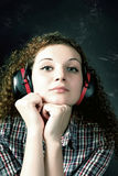 Curly girl in headphones Royalty Free Stock Photos