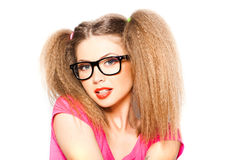 Curly girl with hipster glasses and two tails Stock Photography