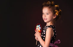 Curly girl with lollipop Royalty Free Stock Photo