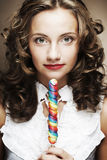 Curly  girl with a lollipop in her hand Stock Photo