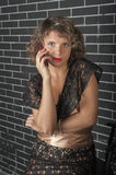 Curly girl with a mobile phone Royalty Free Stock Images