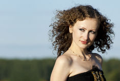 Curly girl on nature. Beautiful curly girl on nature Royalty Free Stock Image