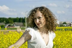 Curly girl on nature Stock Photo
