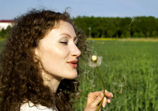 Curly girl on nature. Beautiful curly girl on nature Royalty Free Stock Photography