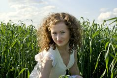Curly girl on nature Royalty Free Stock Photo