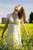Curly girl on nature looking sky royalty free stock photos