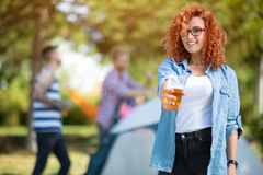 Free Curly Girl Offers A Glass Of Beer Stock Photos - 69416283