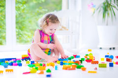 Curly girl playing with blocks Royalty Free Stock Photo