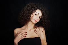 Curly girl with red manicure closeup Stock Photography