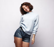 Curly girl smiles broadly Royalty Free Stock Photography