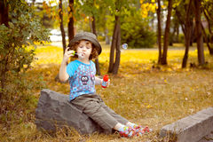 Curly girl and soap bubbles Royalty Free Stock Photography