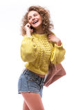 Curly girl talk to someone from smart phone Royalty Free Stock Image