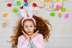Curly girl wearing bunny ears Stock Images