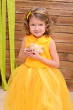 Curly girl in yellow gown with chickens stock photos