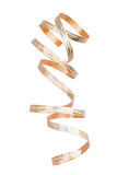 Curly gold ribbon. Isolated on white Royalty Free Stock Image
