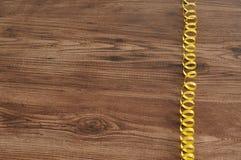 Curly gold ribbon Stock Photos